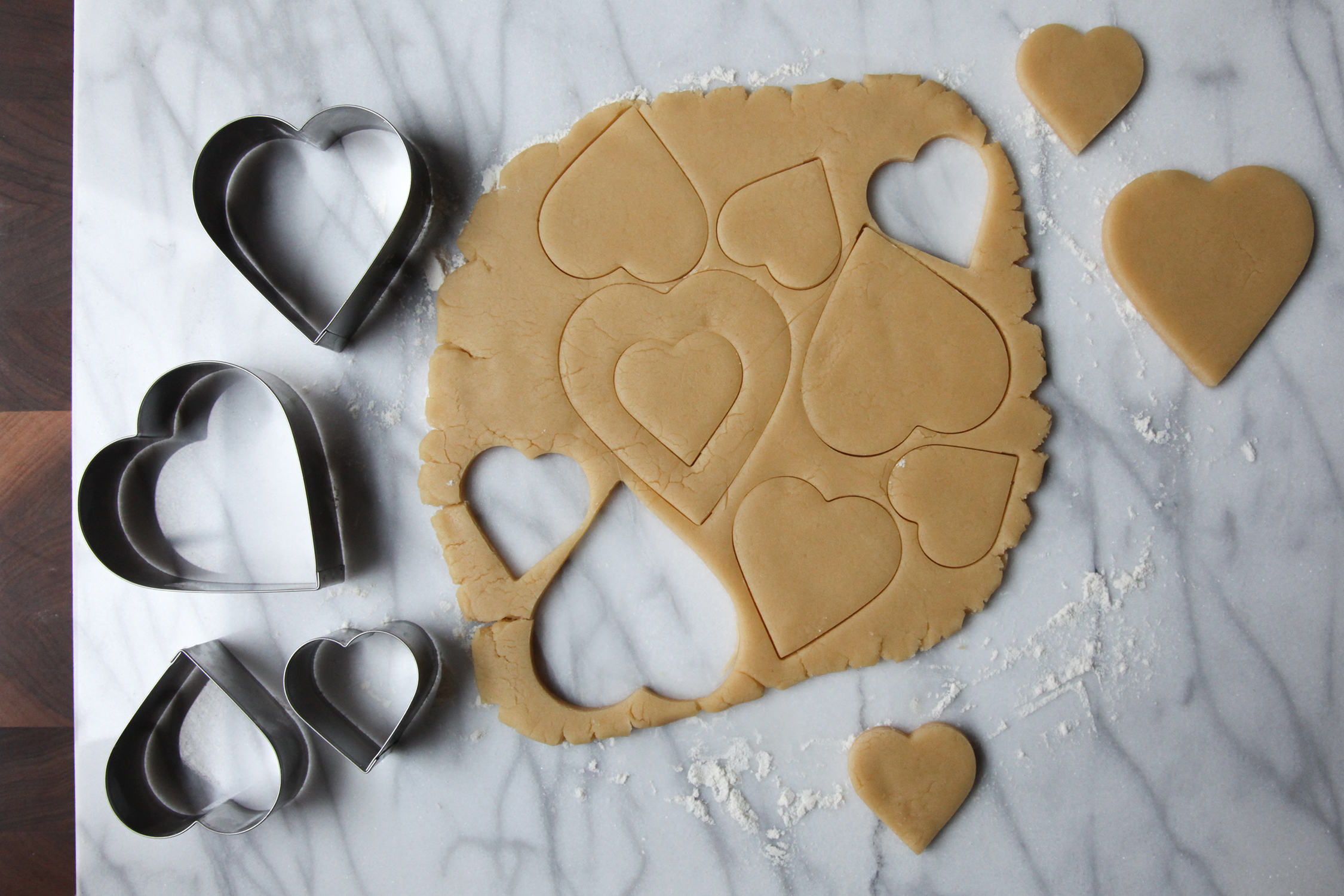 Cutting out heart sugar cookies