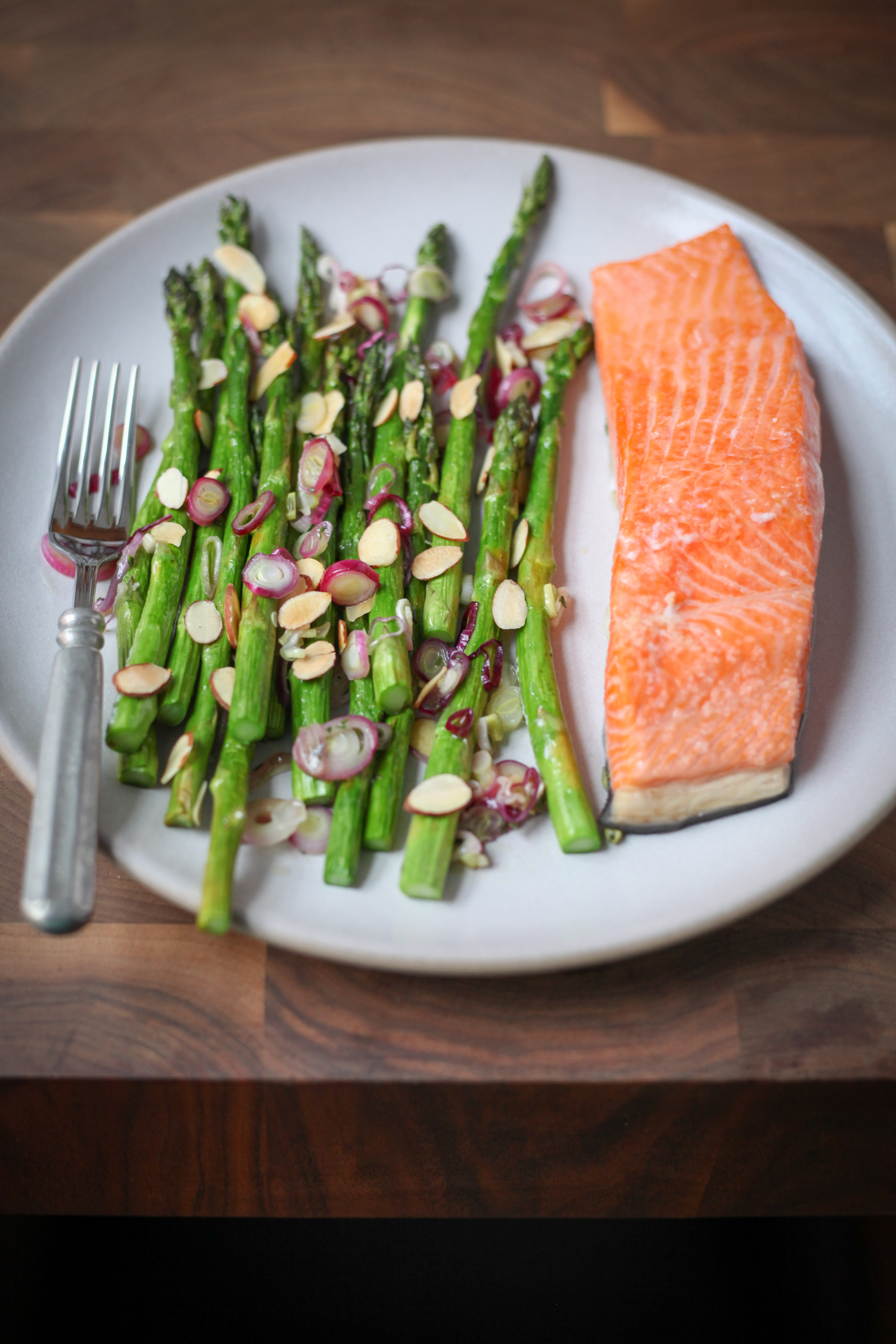 One-Pan Salmon With Asparagus, Spring Onions, and Almonds | amodestfeast.com | @amodestfeast