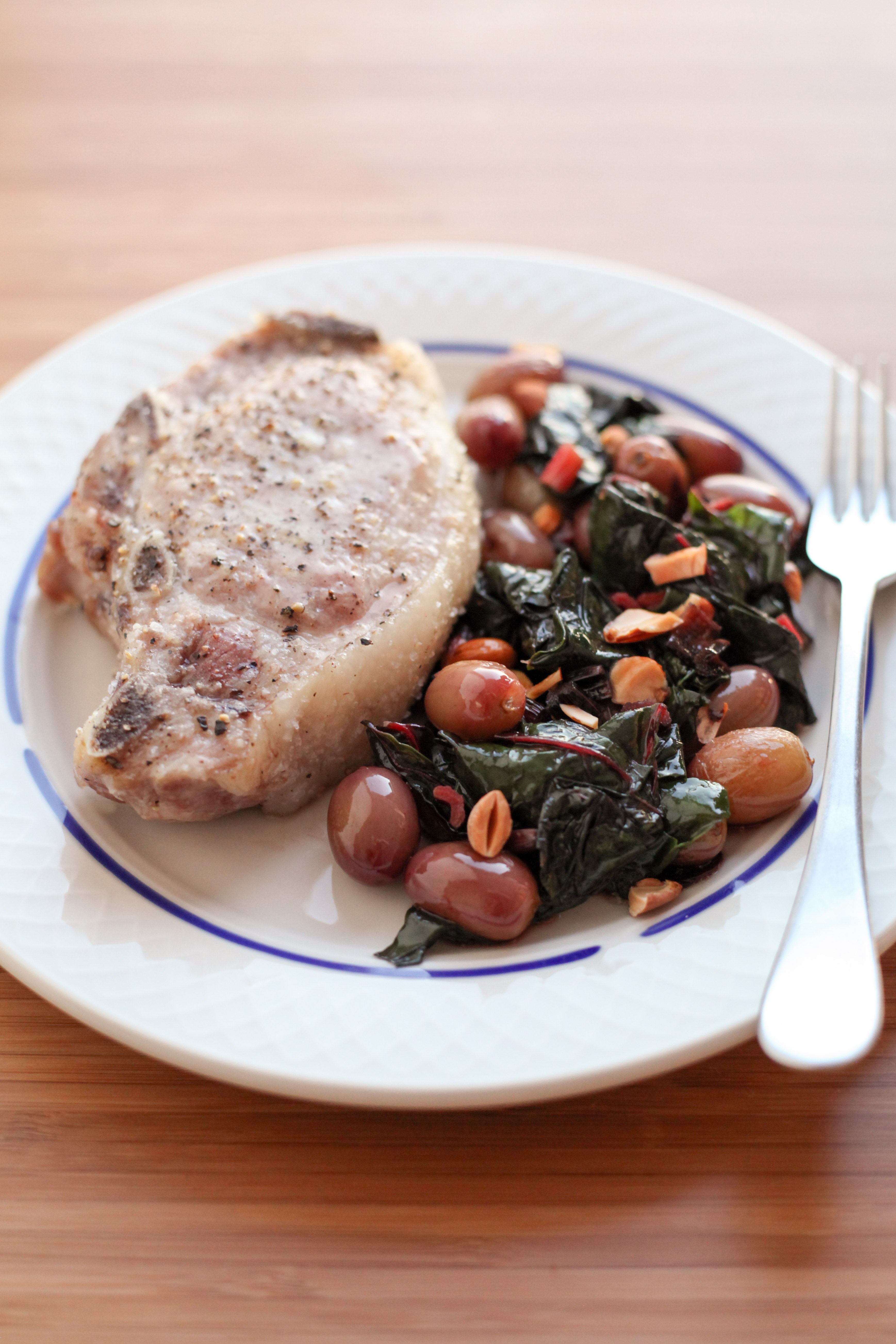 One-Pan Pork Chops With Grapes and Swiss Chard | amodestfeast.com | @amodestfeast